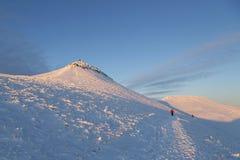 Montaña de la fan de la pluma y en invierno fotografía de archivo libre de regalías