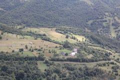 Montaña y paisaje del edificio Foto de archivo
