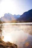 Montañas de la llamarada de la lente Foto de archivo libre de regalías
