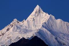Montañas de la nieve de Meili Fotografía de archivo