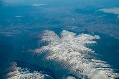 Montañas de la opinión del aeroplano Imágenes de archivo libres de regalías