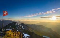 Montañas suizas en la puesta del sol Fotografía de archivo libre de regalías