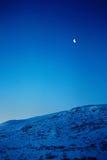 Montañas y luna Imagenes de archivo