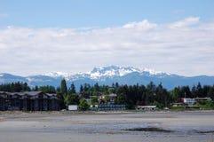 Montañas y playa de la nieve Fotografía de archivo