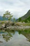 Montañas y reflexión Imagen de archivo