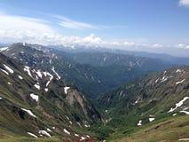 Montañas y valles Imagen de archivo libre de regalías