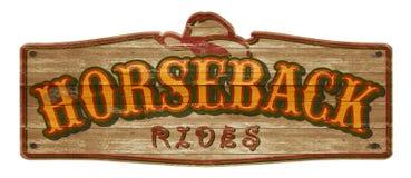 Monta Horseback o sinal ocidental velho imagem de stock royalty free