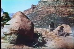 Montage of Apache shootout from rocky outpost stock video footage