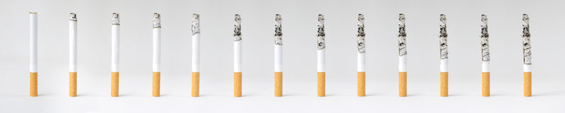 Montage of a burning cigarette in different stages Royalty Free Stock Photography