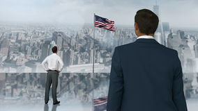 Montage of businessman looking at waving US flag. On city background stock footage