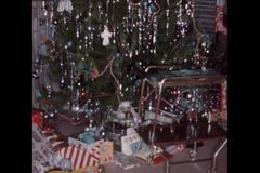 Montage of Christmas decorations and gifts on floor stock footage