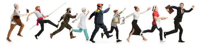 Montage about different professions. Collage of different professions. Group of men, women in uniform running at studio isolated on white. Full length of people royalty free stock photo