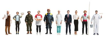 Montage about different professions. Collage about different professions. Group of men and women in uniform standing at studio isolated on white background. Full royalty free stock images