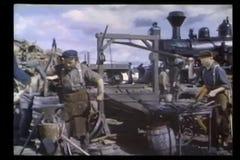 Montage - men building railroad stock footage