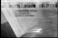 Montage - newspaper headlines and printing press stock footage