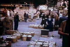 Montage - reenactment of busy outdoor market in 1930s Paris stock video