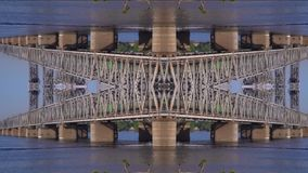 Mirror city, the boat rushes under the bridge with the train, slow motion. Montage video of the fast boat that floats under the steel bridge stock footage