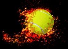 Tennis ball on fire. stock photos