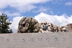 Montagem Rushmore com texto no granito Imagem de Stock