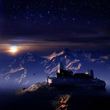 Montagens e castelo sob estrelas