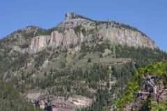 Montagna con roccia eruttiva esposta Fotografie Stock Libere da Diritti