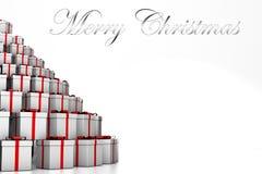 montagna 3D dei regali di Natale e del Buon Natale dell'iscrizione illustrazione di stock