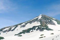 Montagna della neve all'itinerario alpino del kurobe di tateyama delle alpi del Giappone Immagini Stock Libere da Diritti