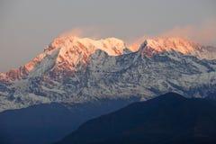 Montagna della neve di alba Fotografia Stock Libera da Diritti