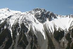 Montagna di neve fusa Immagine Stock