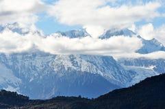 Montagna e villaggio della neve di Meili Immagine Stock