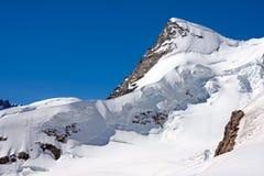 Montagna innevata Jungfraujoch, Svizzera Immagine Stock