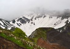 Montagna nelle nubi Fotografia Stock
