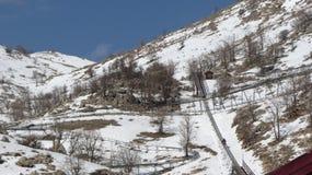 Montagna + scorrevole di Snowy Fotografie Stock