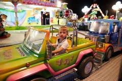 Montagnana, Ιταλία - 14 Ιουλίου 2017: ένα παιδί οδηγά σε ένα λούνα παρκ Στοκ Φωτογραφίες