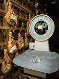 Industrial scale for weighing raw ham thighs in a maturing room. Montagnana, Italy - May 20, 2018: Industrial scale for weighing raw ham thighs in a maturing Royalty Free Stock Photo