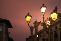 Montagnana, Italy. street lamp shines on the city street. Royalty Free Stock Photo