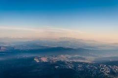 Montagne dalla a qui sopra nel tramonto Immagine Stock Libera da Diritti
