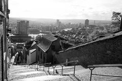 Montagne de Bueren staircase in Liege in Belgium. View of Montagne de Bueren, a 374-step staircase in Liege, Belgium with the view of the city in black and white Royalty Free Stock Photography