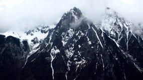 Montagne de neige de Meili Photographie stock