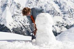 Montagne del pupazzo di neve della ragazza Immagini Stock Libere da Diritti