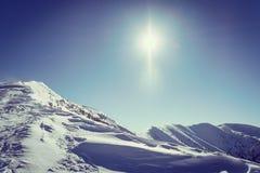 Montagne di Snowy d'annata Immagini Stock