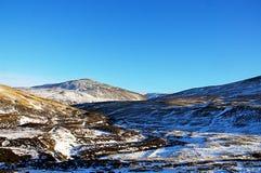Montagne di topazio affumicato di Snowy Fotografia Stock
