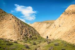 Montagne e alpinista dell'argilla Fotografia Stock Libera da Diritti
