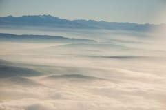 Montagne e nubi Immagini Stock