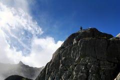 Montagne et homme Photos stock