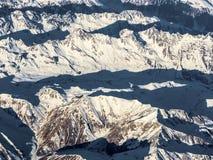 Montagne innevate alle alpi Fotografia Stock Libera da Diritti