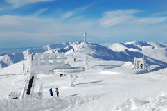 Montagne, neve e cielo blu Fotografia Stock