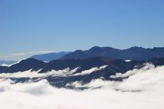 Montagne nuvolose Fotografia Stock