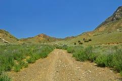 Montagne rocciose nel Kirghizistan Fotografie Stock Libere da Diritti