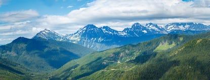 Montagne, valli e panorama delle nuvole Fotografia Stock